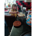 Jasmine is doing a good job helping to bake a cake