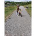Aarav practising riding his bike.