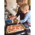 Making a delicious pizza with his daddy
