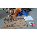 Henry has designed his own board game.