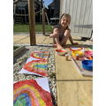 Painting rainbows in the sunshine.