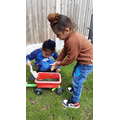 Harmaan and his brother working in the garden.