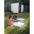 Serenity and her brother Lorenzo painting outside.