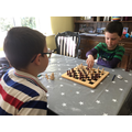 The boys have learnt to play chess-hmm who won?