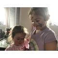 Primrose practising her make up techniques