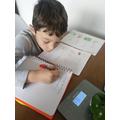 Noah enjoying the weight maths challenge!