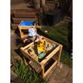 Arthur built a sand castle using his digger