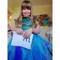 Jasmine practising Read Write. Love the dress too!