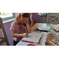 Hannah busy writing!
