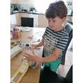 Logan is designing a spaceships.
