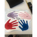Millie and her family made a handprint keepsake