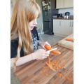 Amelie is busing preparing a meal ...