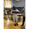 Beekeeper looking for the queen