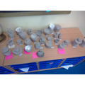 We made canopic jars out of clay.