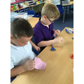 We learnt to use back stitch to join two pieces of material together.
