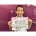 We used watercolours to create a background and then sketched a Greek temple.