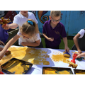 In Art we printed a beach scene using golden paint and sand