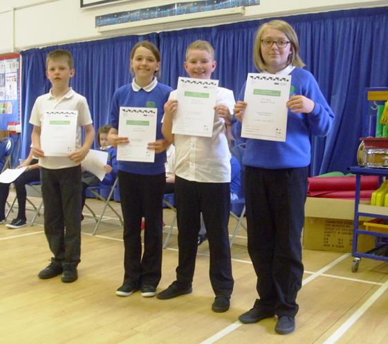 Receiving their certificates in assembly.
