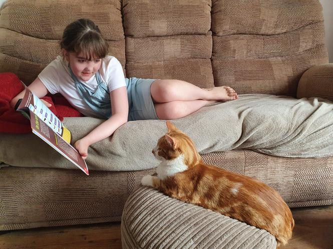 One of Isabelle's cat loves hearing her read...