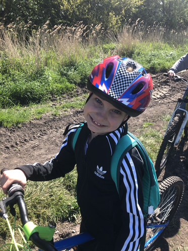 Tom looking happy on his 8 mile cycle