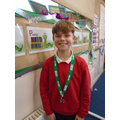 Owen with his silver medal from the Virtual Devon Games Gymnastic competition