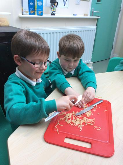 Chopping the spaghetti into shorter pieces.