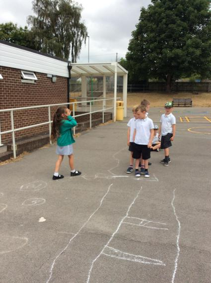 A group leader explaining the hopscotch station.
