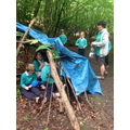Amanda testing how waterproof the dens are.