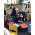 Fun in the reading area with the puppets.