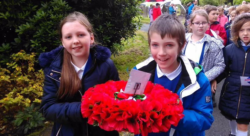 Carefully carrying the wreath.