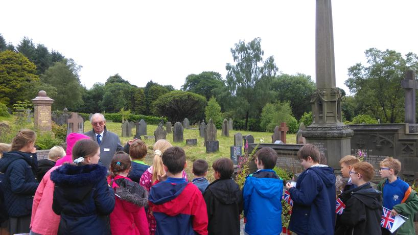 Mr East telling us about the war graves.