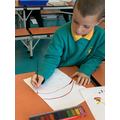 Mixing colours to paint a rainbow