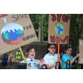 We raised our placards and chanted to get people's attention on climate change.