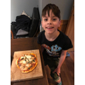 Alex made his own pizza