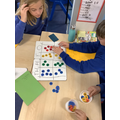 We've been using counters to support learning all about place value!