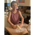 George making Challah bread