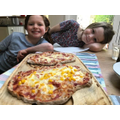 Grace and Hattie making delicious pizza!