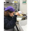 Chef Juan gets busy measuring and mixing the ingredients for his brownies!