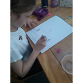 Eve 3EB working on her castle drawing.jpg