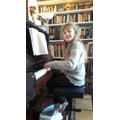 Ada playing the piano.