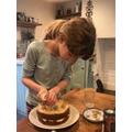 Icing a homemade cake