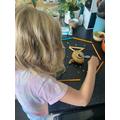 Edith making