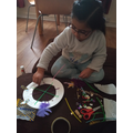 Making her dreamcatcher