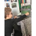 Kiet busy on his laptop