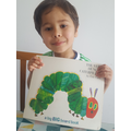 Fazil reading The Very Hungry Caterpillar.png