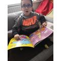 Tyreece-Junior enjoying a book