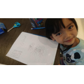 Gia nhi spider maths- adding 8 legs and lots of eyes to her spider. Number bonds to 8.JPG