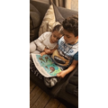 Wail reading to his sister.