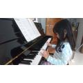 Gia nhi practising on her piano.JPG