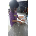Gia nhi making pizza with her mum.JPG